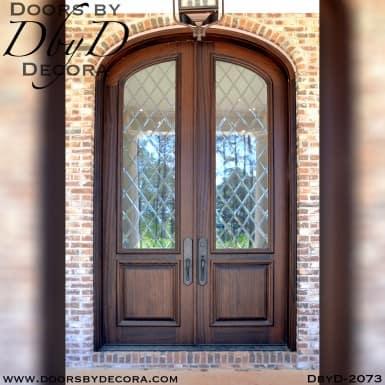 leaded glass elliptical double doors