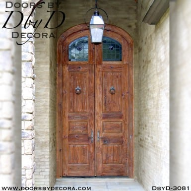 solid door with rustic leaded glass