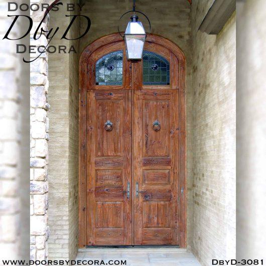 solid door with rustic leaded glass