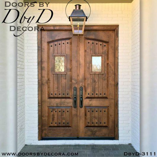solid door arched panel double doors