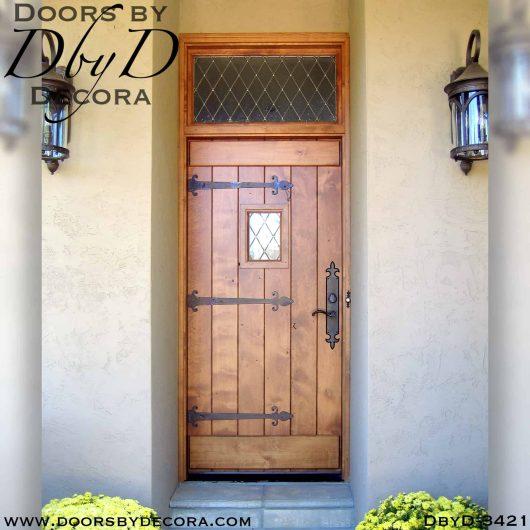 leaded glass plank door with speakeasy