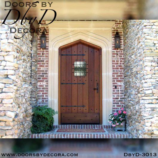 solid door gothic arch plank door