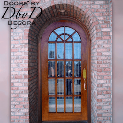 A beautiful craftsman style radius top door featuring beveled glass.
