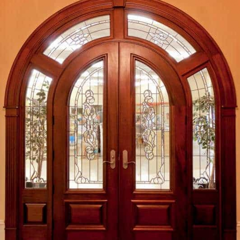 This large estate unit features double radius top doors with a wrap around transom, all featuring leaded glass.