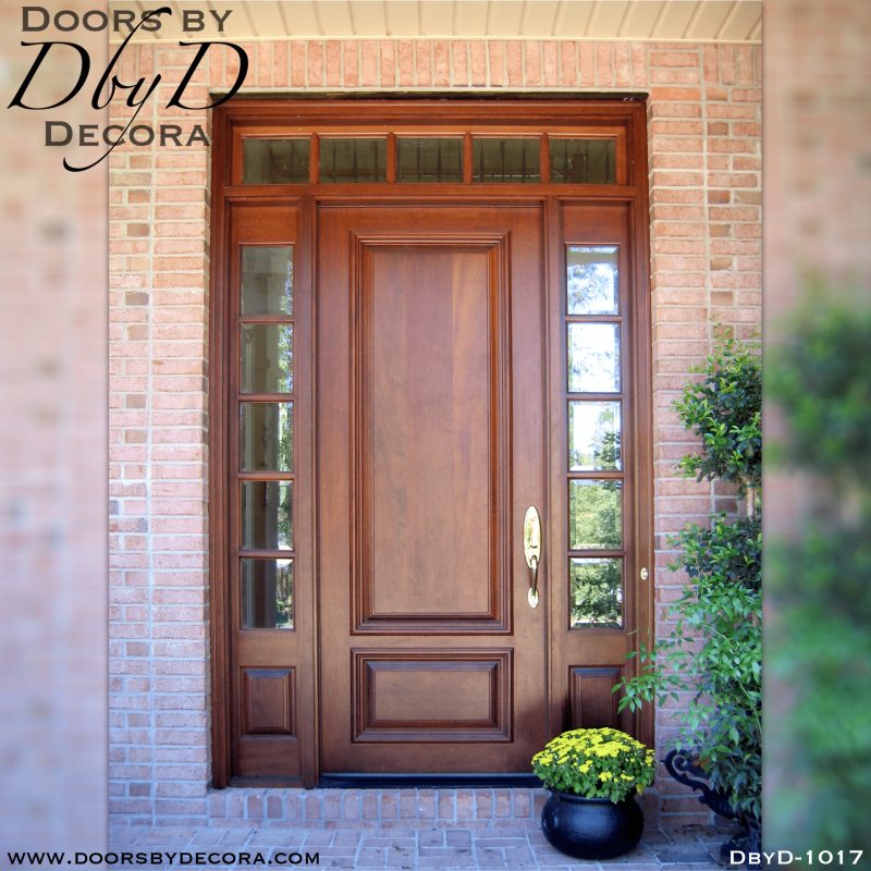 A beautiful and traditional solid wood door with two sidelites and a transom.