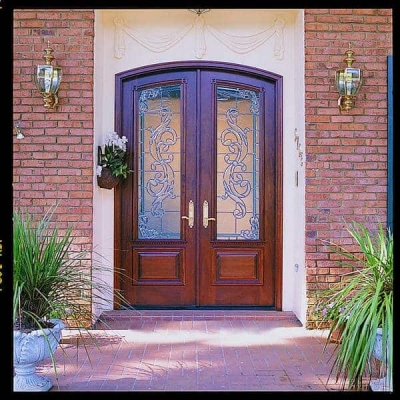 A pair of common segment double doors featuring custom leaded glass.
