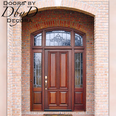 A three piece transom sits atop this beautiful four panel door and side lites.