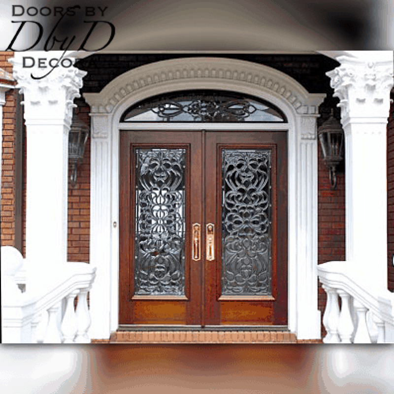 A close-up look at the custom wood doors, elliptical transom and custom jamb molding designed and provided by Doors by Decora.