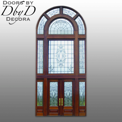 An extra tall grand entrance custom designed and built by Doors by Decora featuring leaded glass.