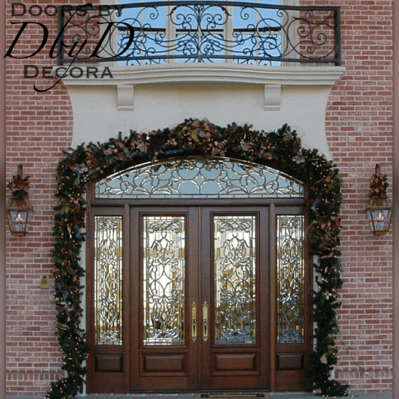 A close-up shot of the custom entrance on this traditional home.