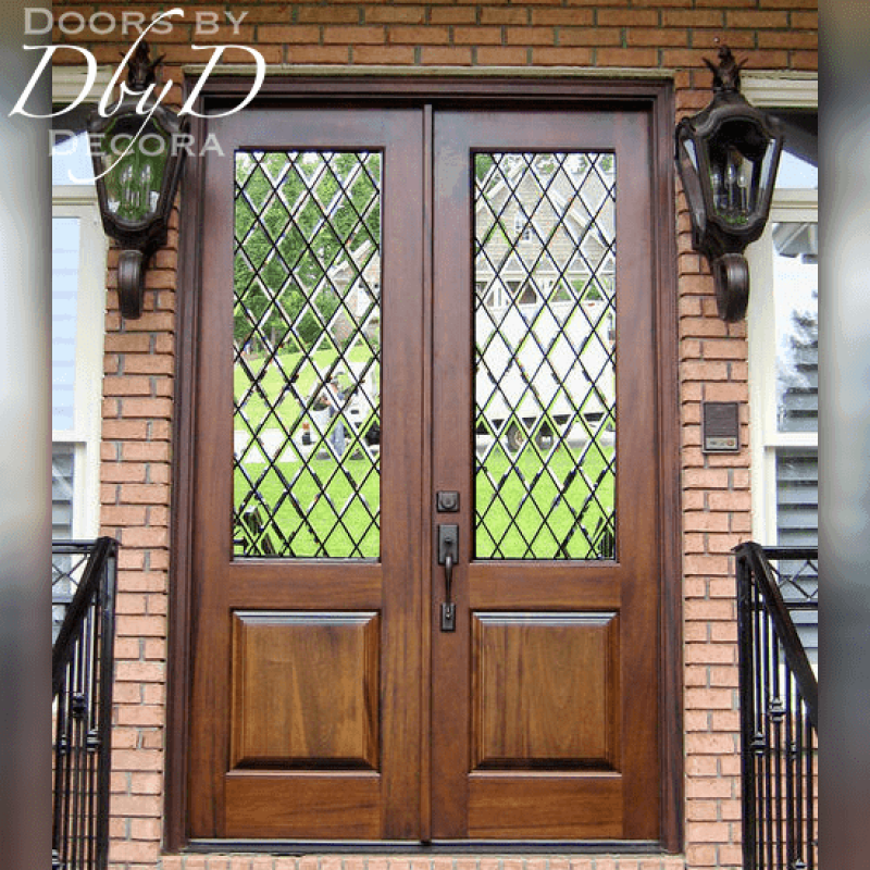This simple pair of double doors features leaded beveled glass.