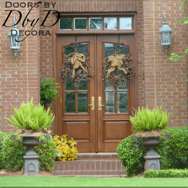 A pair of double doors and matching transom with beveled glass.