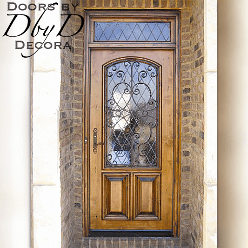 This country french door features leaded glass and a custom wrought iron grill.
