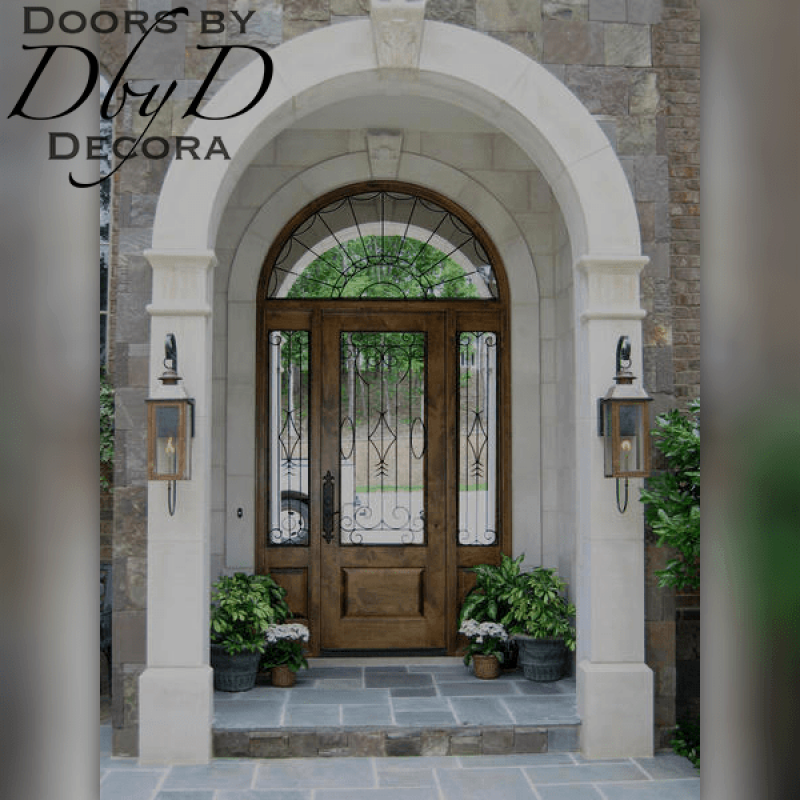 A beautiful country french entry unit featuring custom wrought iron grills.