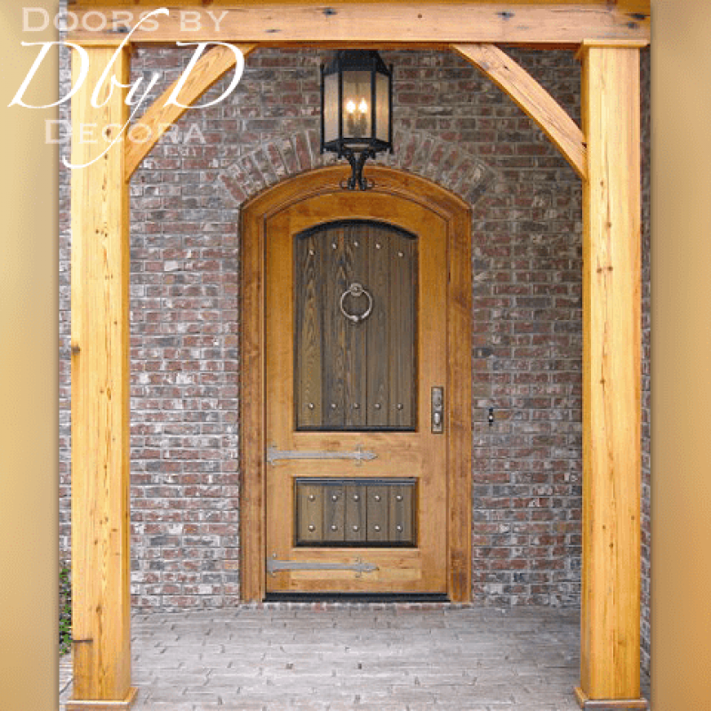 A beautiful old world style door utilizing two different stain colors and decorative hardware.