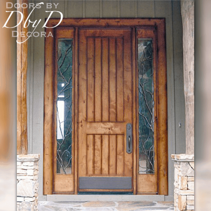A beautiful eight foot tall old world door with custom wrought iron grills in the side lites.