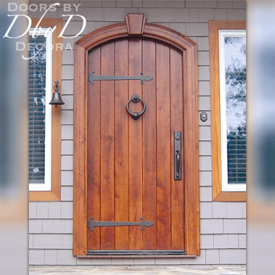 A beautiful old world style door shown with decorative hardware.
