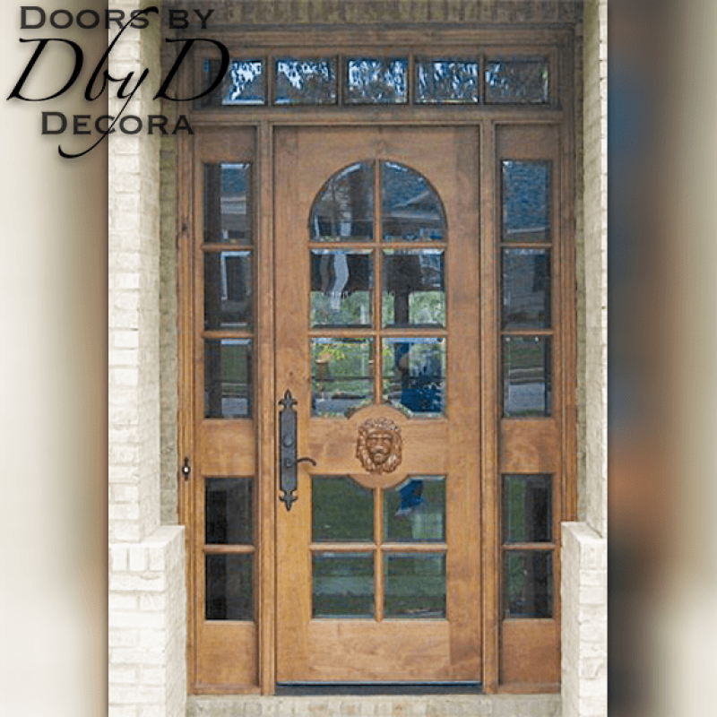 "A version of our ""Lion"" doors featuring a door, two side lites, and a transom."