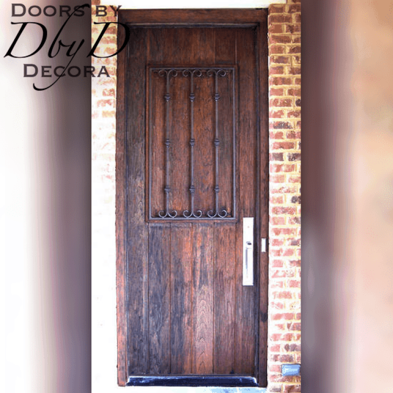 This unique old world style door features a custom wrought iron grill.
