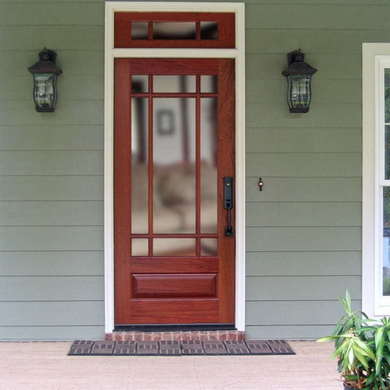 A very traditional craftsman style door and transom.