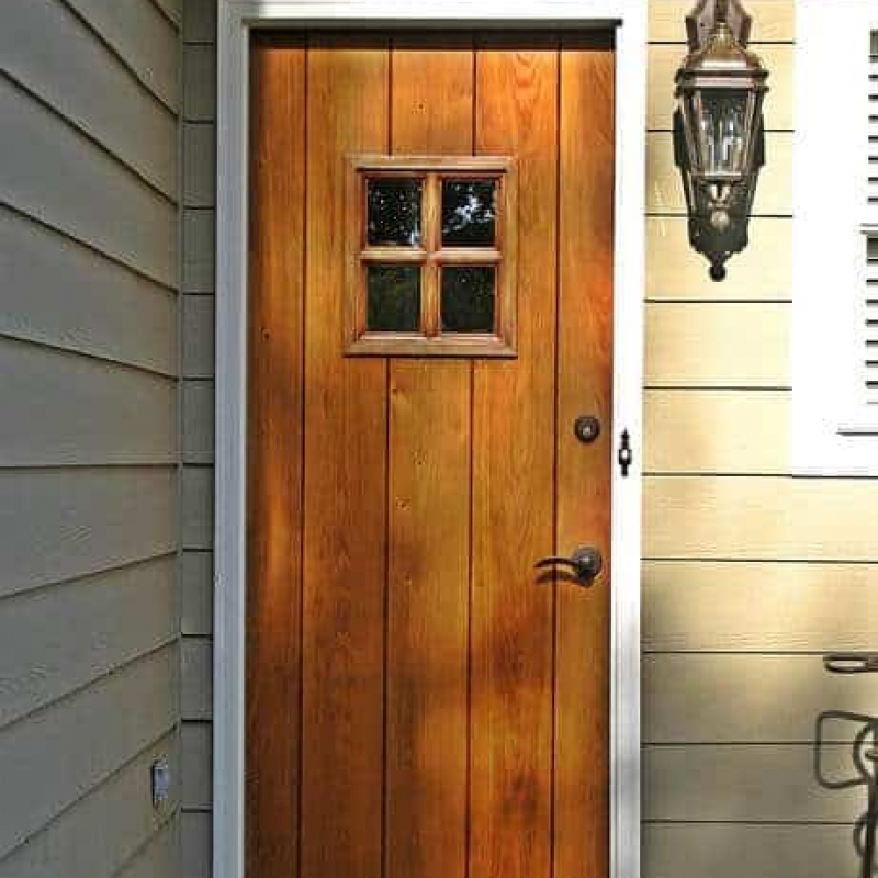 A small true divided lite window highlights this craftsman style entrance.