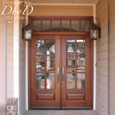 This beautiful craftsman style entrance features double doors and a rectangular transom.