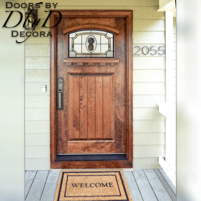 A traditional craftsman style door featuring hand painted glass.