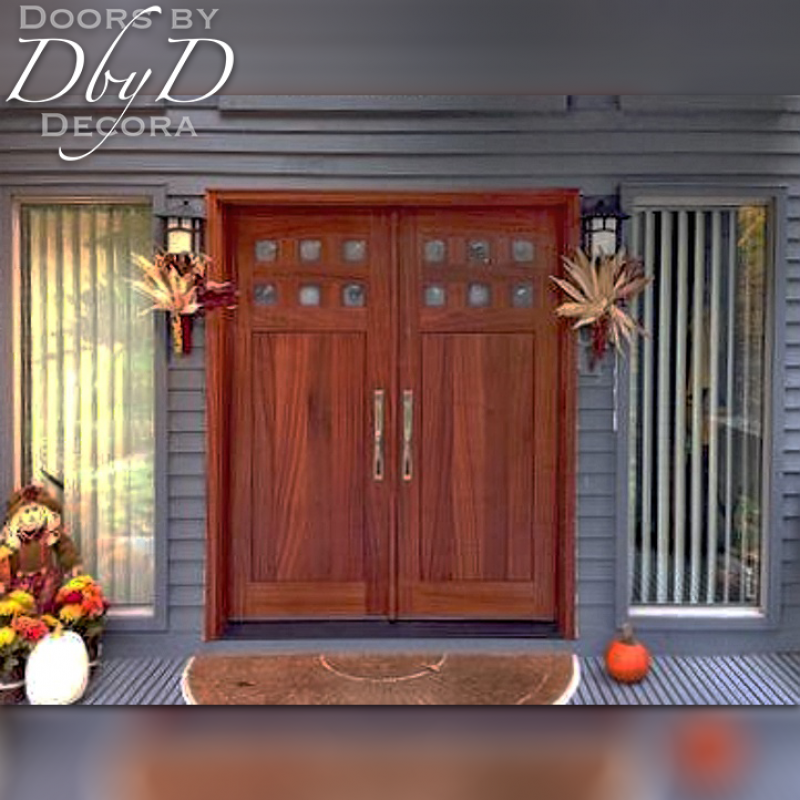A beautiful craftsman example featuring double doors with six lites over flat panels.