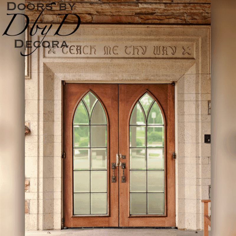 This pair of gothic arch doors add a touch of class to this rectangular opening.